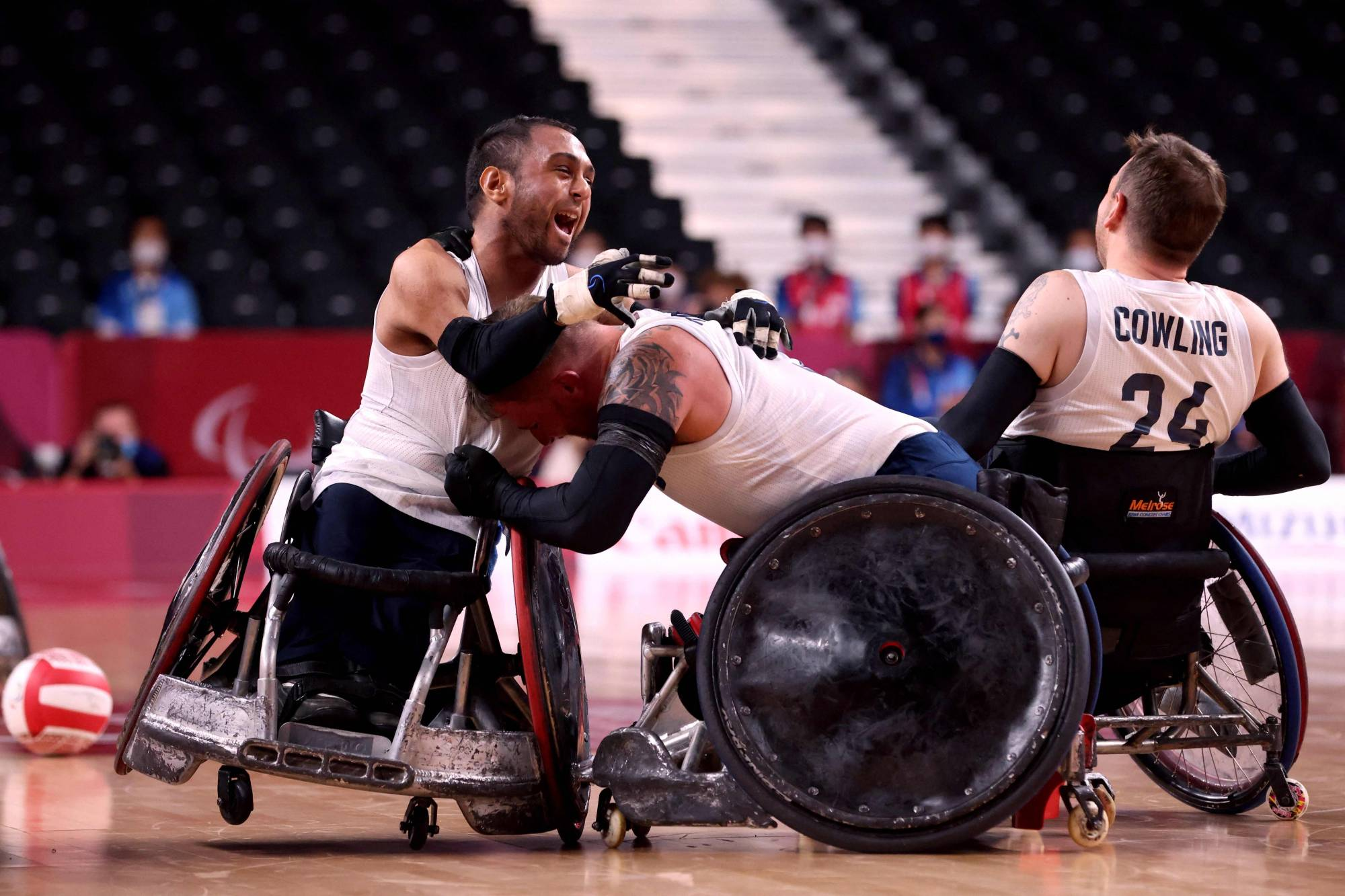 Britain's players celebrate their victory in the wheelchair rugby gold medal match against the United States. | AFP-JIJI