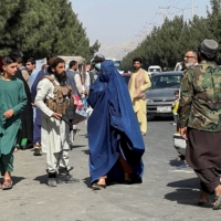 Taliban forces block the roads around the airport in Kabul on Friday.    REUTERS