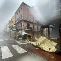 A section of a building's roof is blown off during rain and winds in the French Quarter of New Orleans, Louisiana, on Sunday.  | AFP-JIJI