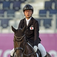 Soshi Yoshigoe and his horse Hashtag compete in the equestrian Dressage Individual Test Grade II event at the Tokyo Paralympics on Thursday. | KYODO
