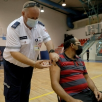 A paramedic administers a booster shot of the Pfizer-BioNTech COVID-19 in Holon, Israel, on Aug. 24.   AFP-JIJI