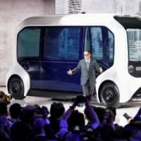 Toyota Motor Corp. President Akio Toyoda shows the e-Palette autonomous concept vehicle at the Tokyo Motor Show in October 2019. | REUTERS