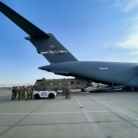 A CH-47 Chinook helicopter is loaded onto a U.S. Air Force C-17 Globemaster III at Hamid Karzai International Airport in Kabul, Afghanistan, on Saturday. The Chinook is one of the pieces of equipment returning to the U.S. as the military mission in Afghanistan comes to an end.   U.S. CENTRAL COMMAND / VIA REUTERS