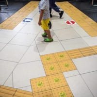 The yellow sidewalk panels known as tenji blocks, which are designed to help people with visual impairments, are seen at a train station in Tokyo on Sunday.   AFP-JIJI