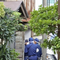 Police officers conduct investigations in Niigata on Tuesday, near an area where a high school girl was found dead with bleeding around her chest.   KYODO