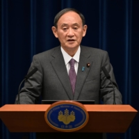Prime Minister Yoshihide Suga speaks during a news conference in Tokyo on Aug. 25. | POOL / VIA REUTERS