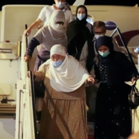 Afghan evacuees arrive in the Albanian capital of Tirana on Saturday. | REUTERS