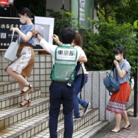 Young people line up for the COVID-19 vaccine lottery in Tokyo's Shibuya Ward on Sunday. | KYODO