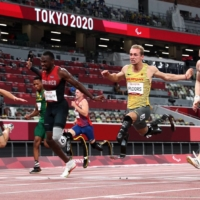 Just 0.03 seconds separated gold medalist Felix Streng of Germany, silver medalist Sherman Isidro Guity Guity of Costa Rica, bronze medalist Johannes Floors of Germany and bronze medalist Jonnie Peacock of Britain at the finish line of the men's T64 100-meter final at the 2020 Tokyo Paralympics on Monday. | REUTERS