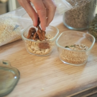 Put together a blend of assorted nuts and seeds. | SIMON DALY