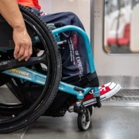 Dedicated facilities for disabled commuters on trains are typically also used by other travelers, with disabled individuals often needing to share such spaces with pregnant women, parents with strollers, older people and other groups with access needs. | AFP-JIJI