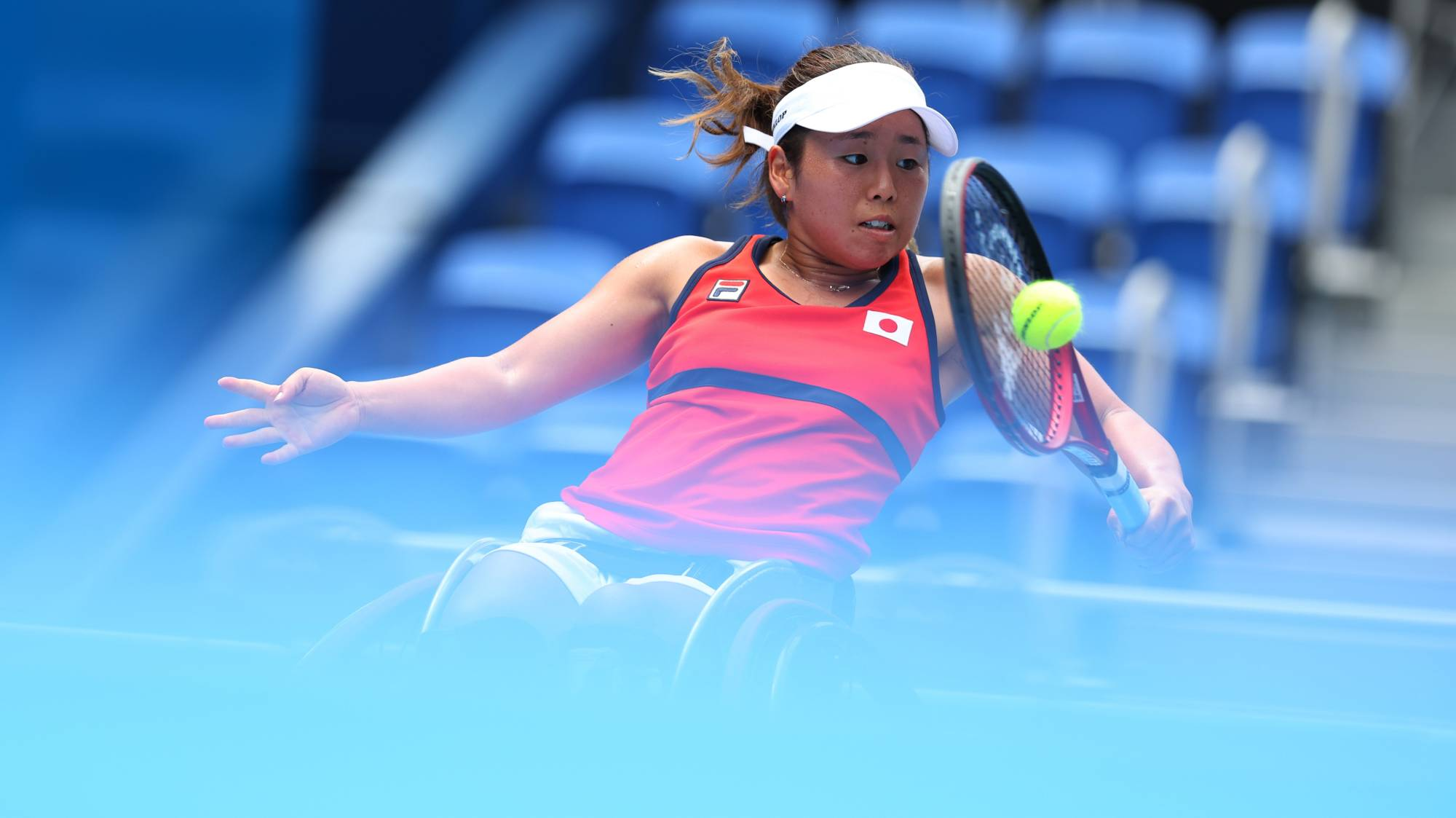 Yui Kamiji of Japan in action against Zhenzhen Zhu of China in the quarterfinal of the women's wheelchair tennis competition   REUTERS