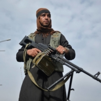 A Taliban fighter attends a rally in Kabul on Tuesday.  | AFP-JIJI