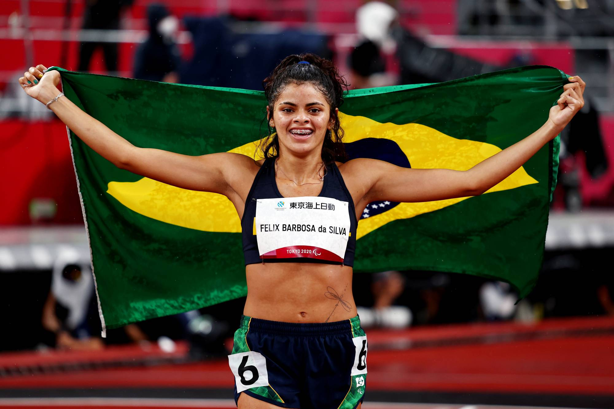 Jardenia Felix Barbosa Da Silva of Brazil celebrates after finishing third in the women's T20 400 meters. In Tokyo, only around 120 of the 4,400 athletes competing are classed as having an intellectual impairment.   REUTERS