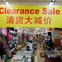 An empty tourist gift shop in Singapore's Chinatown on Monday | REUTERS