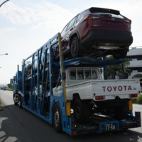 Toyota Motor Corp. vehicles are transported on a car carrier trailer near the Nagoya port on Aug. 23. | BLOOMBERG