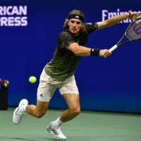 Greece's Stefanos Tsitsipas hits a return to France's Adrian Mannarino during their second round match Wednesday.    AFP-JIJI