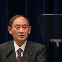 Prime Minister Yoshihide Suga speaks during a news conference in Tokyo on Aug. 25. | POOL /VIA REUTERS