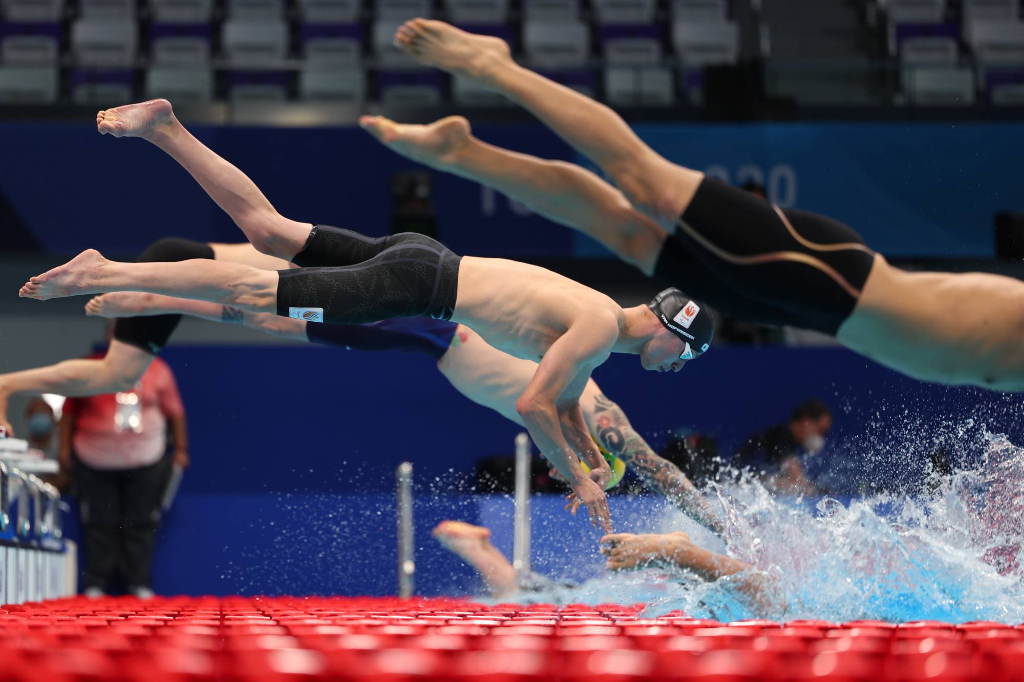 The start of a qualifying heat for the men's S6 100-m freestyle   REUTERS