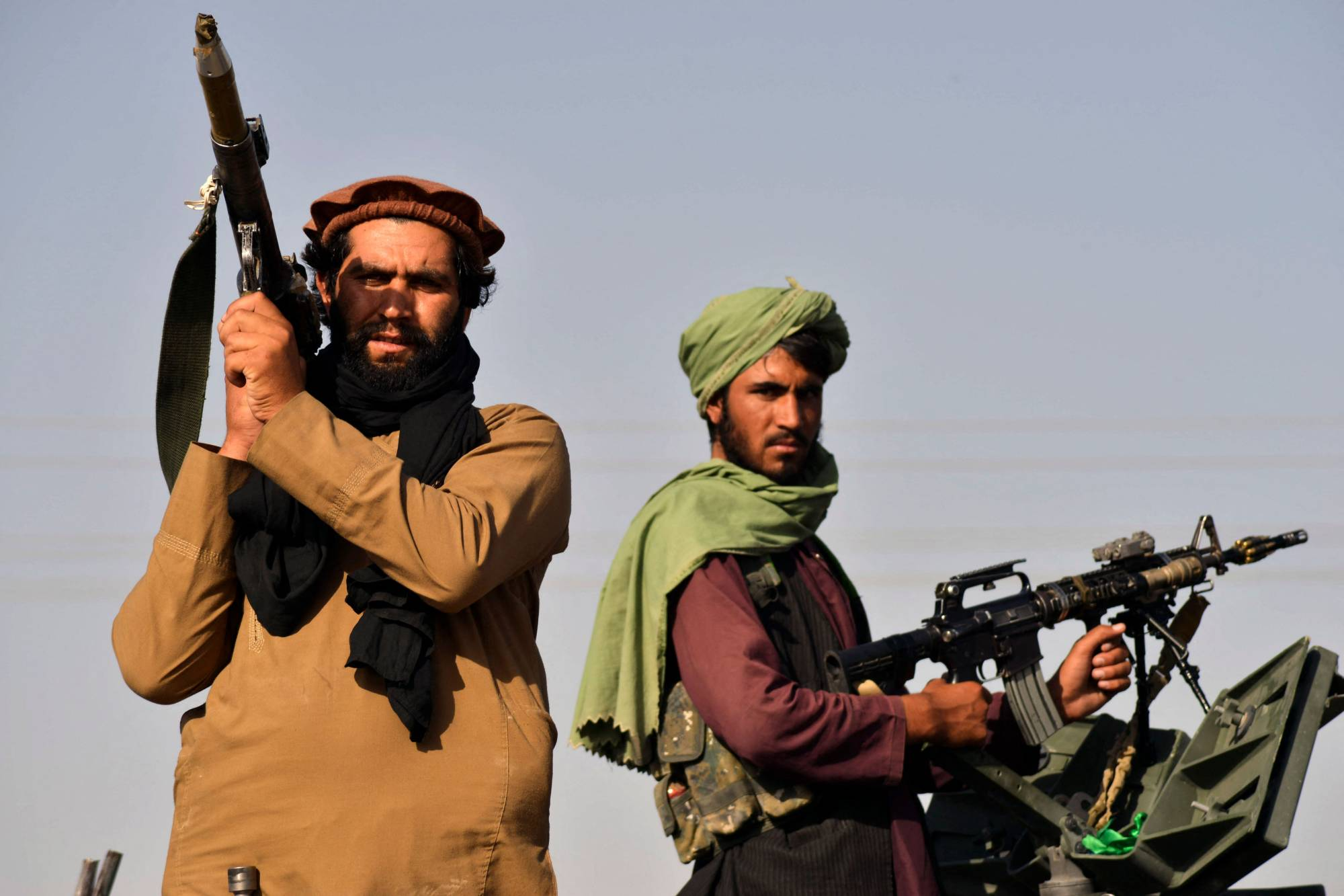 Taliban fighters in the city of Kandahar on Wednesday celebrate the withdrawal of U.S. forces from Afghanistan. | AFP-JIJI