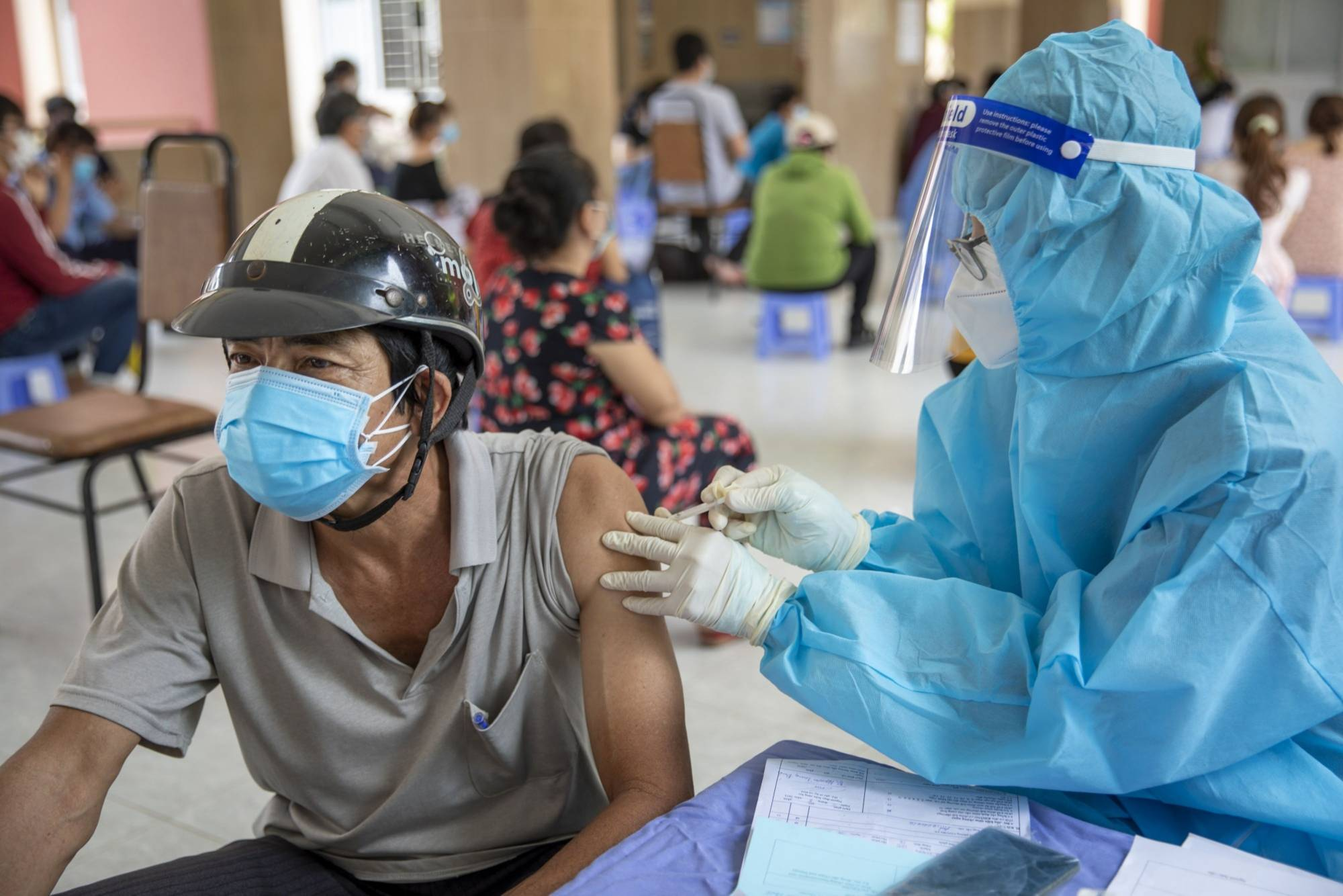 A vaccination center in Ho Chi Minh City, Vietnam, in August | BLOOMBERG