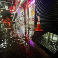 Rainfall from the remnants of Hurricane Ida floods the basement of a fast food restaurant in the Bronx, New York, on Wednesday.  | GETTY IMAGES / VIA BLOOMBERG