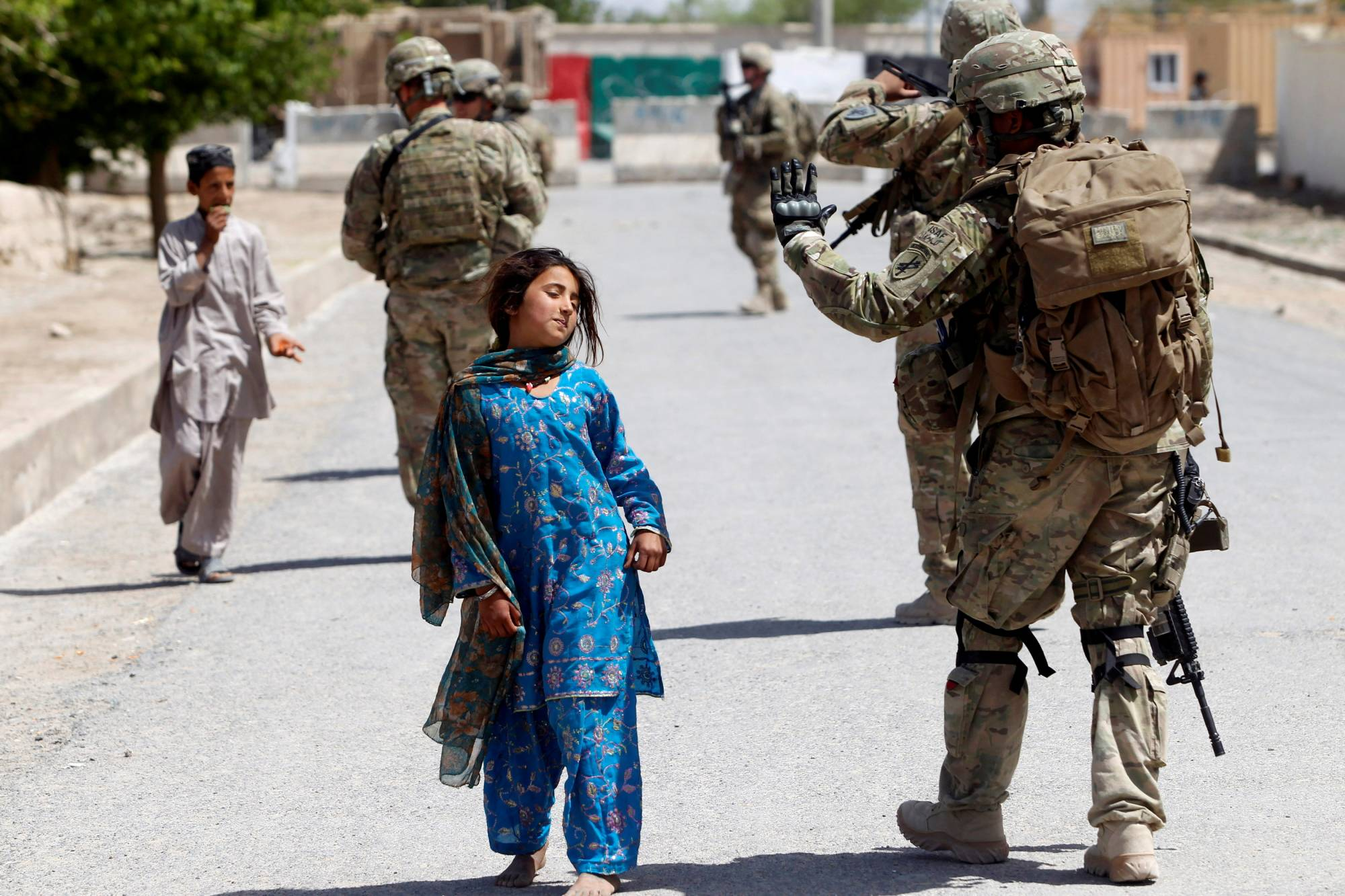U.S soldiers conduct a patrol in Kandahar province in April 2012. U.S. allies like Japan should take heart in the withdrawal decision as it means Washington will no longer be distracted by the 'forever war.'   REUTERS
