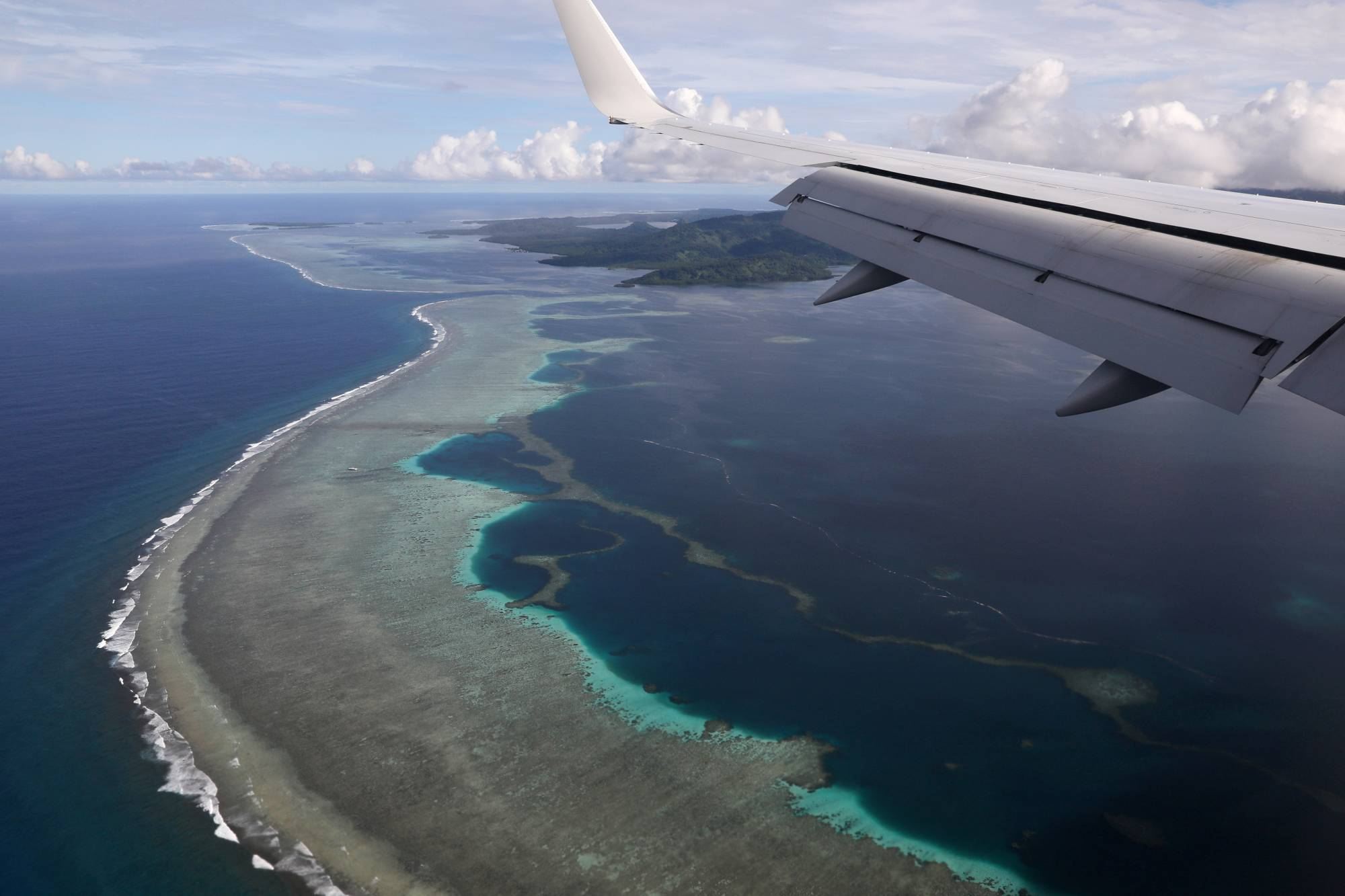 Then-U.S. Secretary of State Mike Pompeo's plane makes its landing approach near Pohnpei International Airport in Kolonia, Federated States of Micronesia, in 2019. | REUTERS