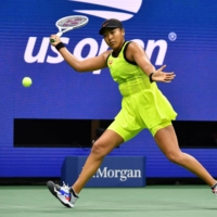 Naomi Osaka hits a return to Canada's Leylah Fernandez during their 2021 U.S. Open Tennis tournament women's singles third round match at the USTA Billie Jean King National Tennis Center in New York on Friday. | AFP-JIJI