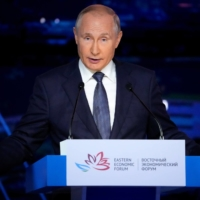 Russian President Vladimir Putin delivers a speech at the Eastern Economic Forum in Vladivostok, Russia, on Friday.   POOL / VIA REUTERS