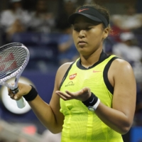 Naomi Osaka raises her arms in frustration after missing a shot against Leylah Fernandez.  | USA TODAY / VIA REUTERS