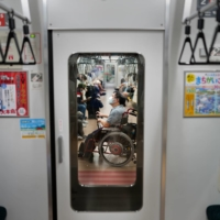 Yuto Hirano, a volunteer for the Paralympics, on the subway in Tokyo on Aug. 23. Hirano said he wished that the Paralympics could have had international spectators, who could have assessed Tokyo's accessibility measures. | CHANG W. LEE/THE NEW YORK TIMES