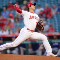 Los Angeles Angels starting pitcher Shohei Ohtani throws against the Texas Rangers on Friday.  | USA TODAY / VIA REUTERS