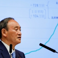 Prime Minister Yoshihide Suga attends a news conference on Japan's response to the coronavirus pandemic, at his official residence in Tokyo on June 17. | POOL / VIA REUTERS