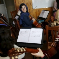 Members of the Zohra orchestra, an ensemble of 35 women, rehearse in 2016.    REUTERS