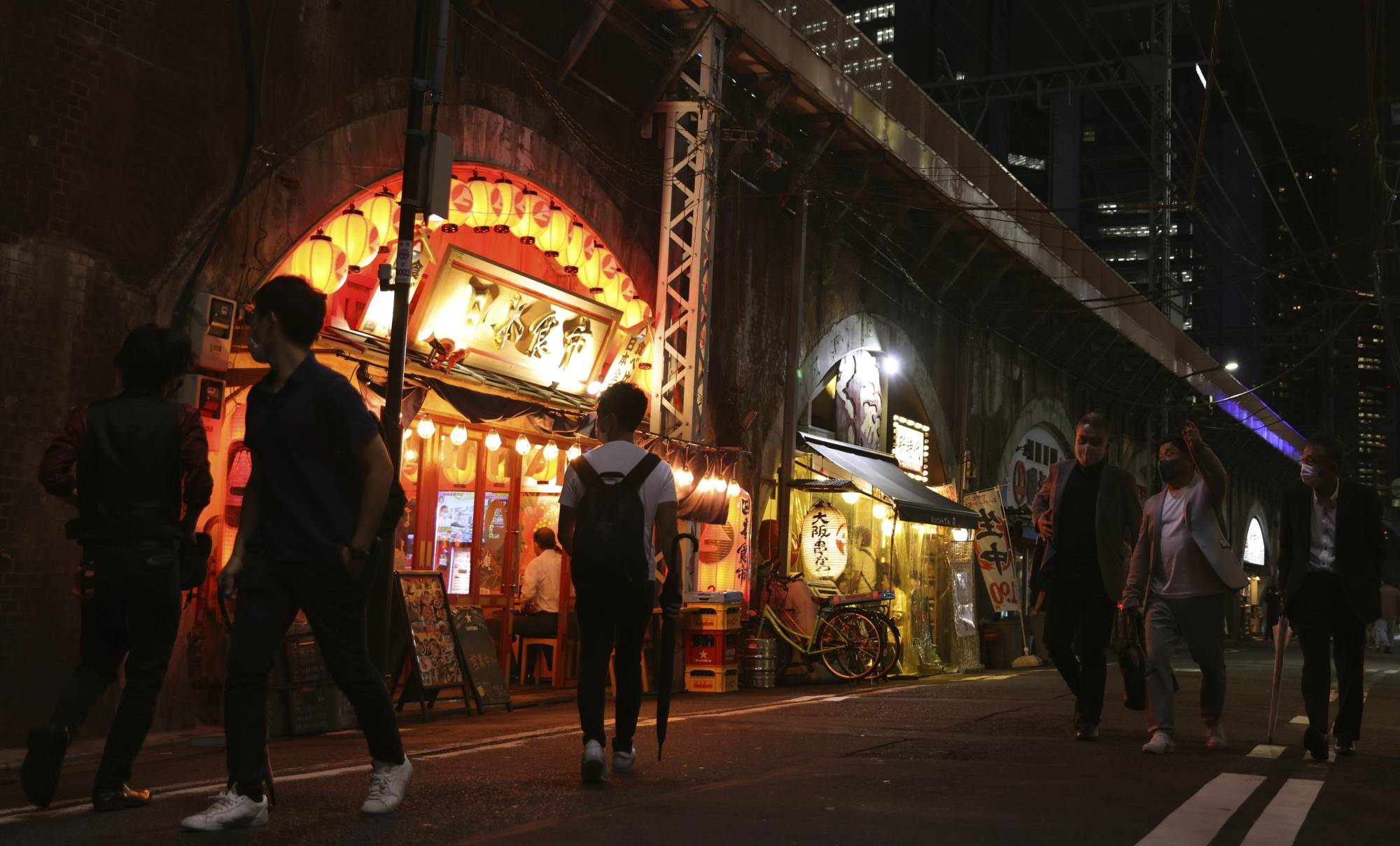 A street in Tokyo's Shimbashi district on Wednesday night | KYODO