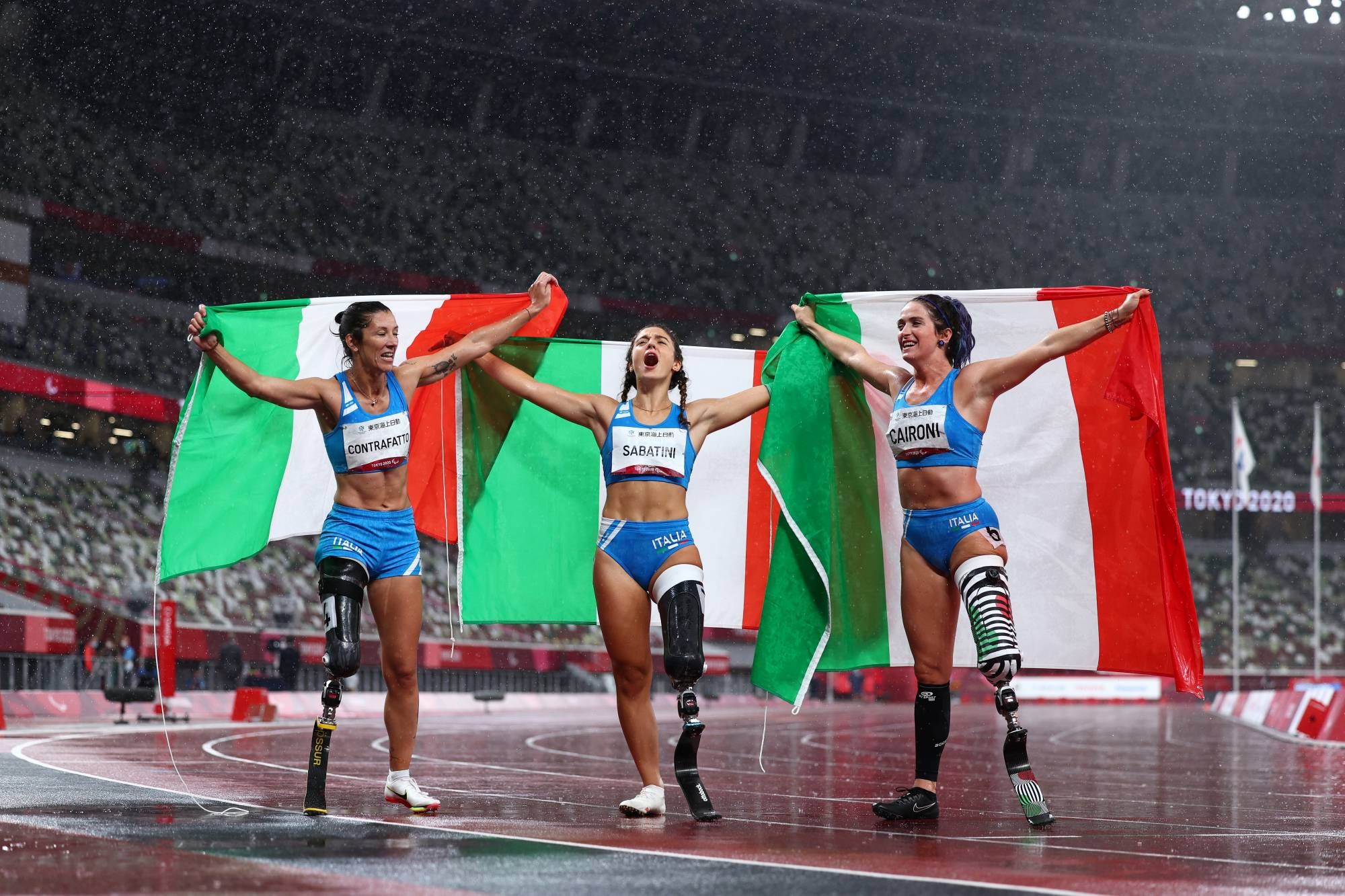 Team Italy celebrates sweeping the top spots in the women's T63 100 meters. From left: Monica Graziana Contrafatto (bronze), Ambra Sabatini (gold) and Martina Caironi (silver). Sabatini also broke the world record.   REUTERS