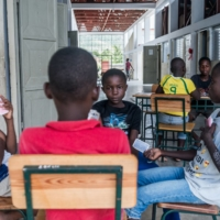 Boys play cards at a temporary shelter following a recent deadly earthquake, in Chardonnieres, Haiti. | AFP-JIJI