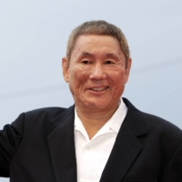 Vehicle carrying famed Japanese director Takeshi Kitano attacked with pickax