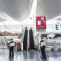 A nearly empty departures hall is seen at Tokyo's Haneda Airport on Aug. 9. | BLOOMBERG