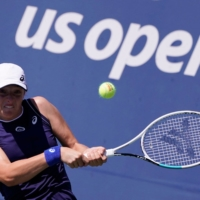 Poland's Iga Swiatek has openly spoken about her struggles with the pressures of pro tennis.   AFP-JIJI