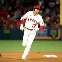 Angels designated hitter Shohei Ohtani rounds the bases after hitting his 43rd home run of the season on Saturday in Anaheim, California. | USA TODAY / VIA REUTERS