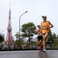 Misato Michishita and her guide run past Tokyo Tower during the women's T12 marathon on Sunday, the last day of the Tokyo Paralympics. | KYODO
