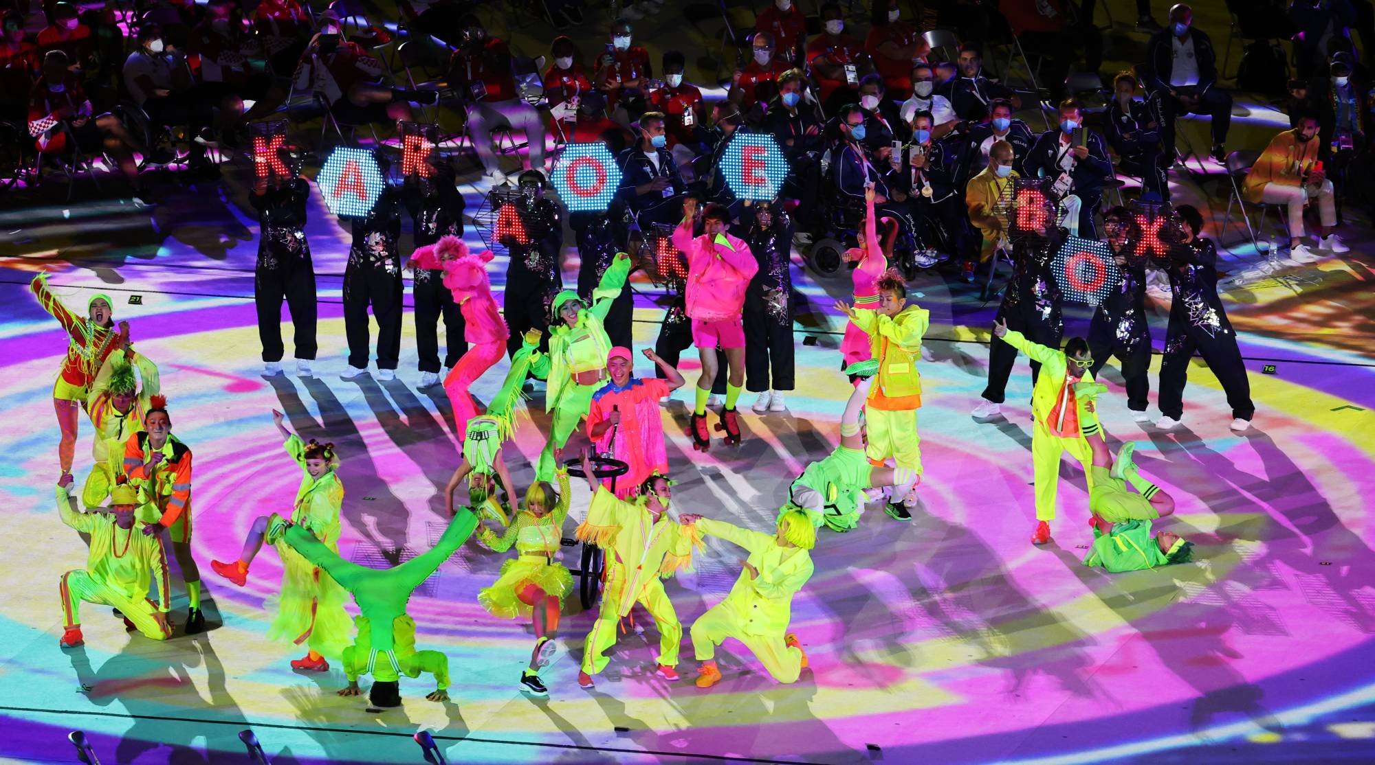Colorfully dressed dancers and musicians perform during the closing ceremony. | REUTERS