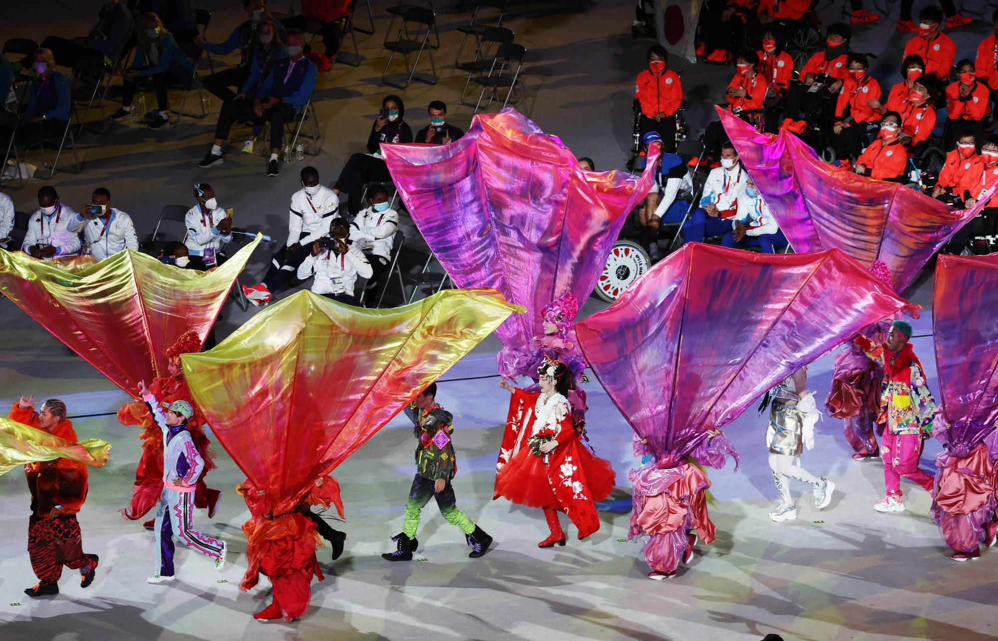 Costumed performers parade during the closing ceremony. | REUTERS