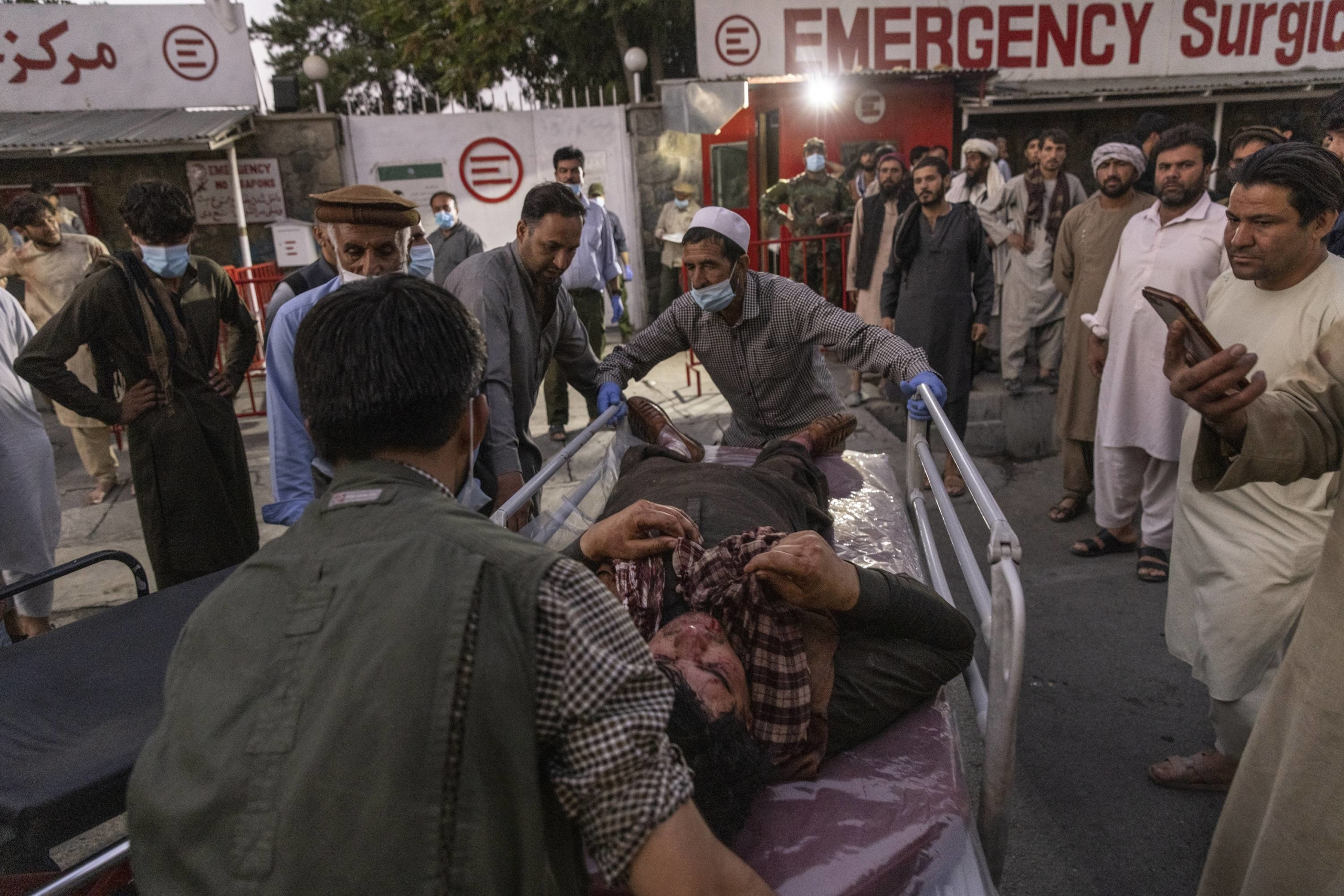 A person wounded in a bomb blast outside Kabul's airport in Afghanistan on Aug. 26 arrives at a hospital. | VICTOR J. BLUE / THE NEW YORK TIMES