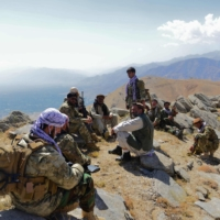 Afghan resistance movement and anti-Taliban uprising forces rest as they patrol on a hilltop in the Anaba district of Panjshir province on Sept. 1. | AFP-JIJI