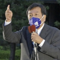 Japan's opposition parties rattled by Suga's move toward exit