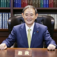 Yoshihide Suga sits in the chair of president of the ruling Liberal Democratic Party at the party's headquarters office in Tokyo on Sept. 14, 2020, the day he was elected the party's president. | KYODO
