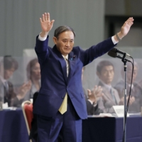 Yoshihide Suga is applauded after being elected as the ruling Liberal Democratic Party's president on Sept. 14, 2020. | KYODO
